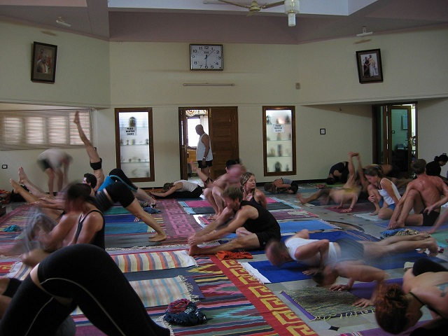 Mysore style class at the main <i>shala</i> of KPJAYI with Guruji.
